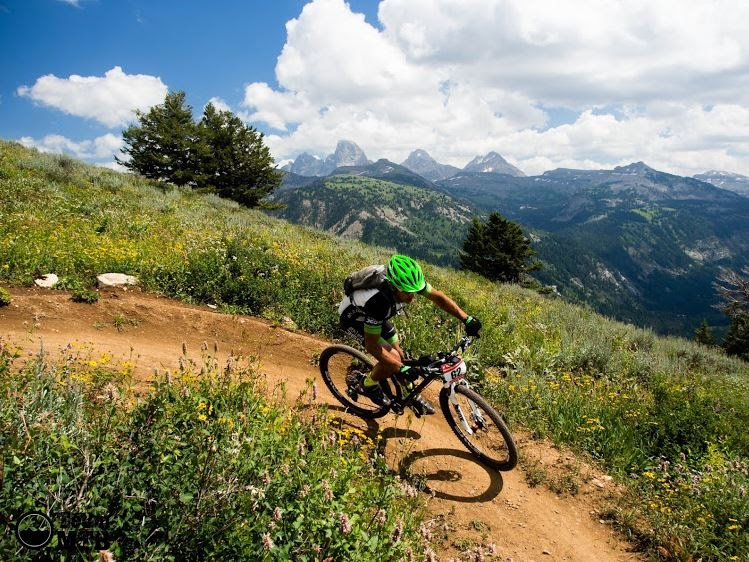 One of the top switchbacks of 38 special. It really is super special. Thats not me, but it was the day of the event, Tetons in the background. Stunning place to suffer!